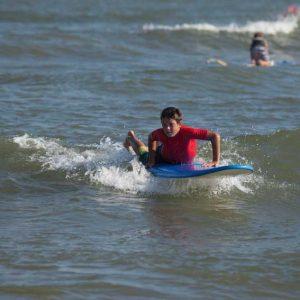 alumno de surf en Punta del Moral , Huelva con Kanela Sailing School